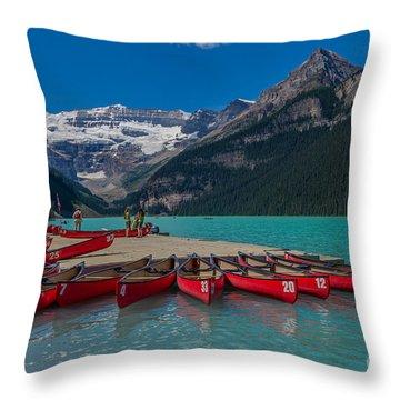 Canoes On Lake Louise Throw Pillow by John Roberts