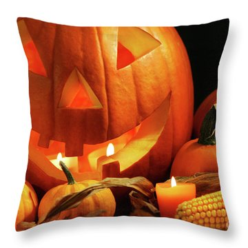 Carved Pumpkin With Candles Throw Pillow