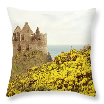 Throw Pillow featuring the photograph Castle Ruins And Yellow Wildflowers Along The Irish Coast by Juli Scalzi