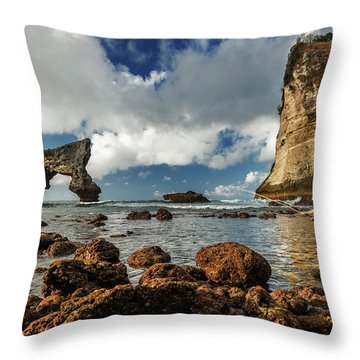 Throw Pillow featuring the photograph catching fish in Atuh beach by Pradeep Raja Prints