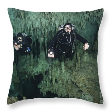 Cave Divers In Dreamgate Cave System Throw Pillow by Karen Doody