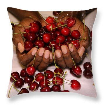 Throw Pillow featuring the photograph Cherry In The Hands by Paul SEQUENCE Ferguson             sequence dot net