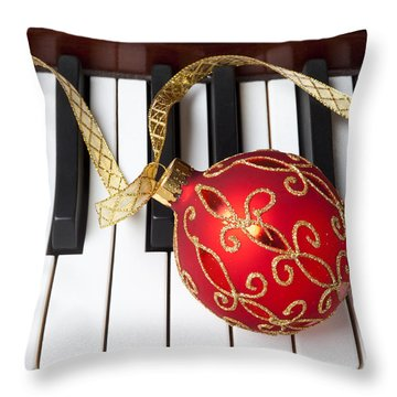 Christmas Ornament On Piano Keys Throw Pillow by Garry Gay