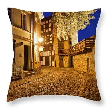 City Of Torun At Night Throw Pillow