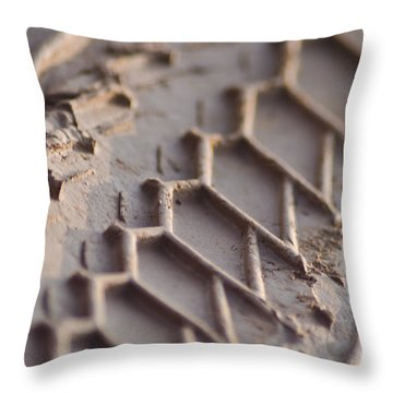 Close Up Of Motorcycle Tread Pattern On Muddy Trail Throw Pillow