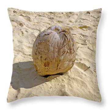 Throw Pillow featuring the photograph Coconut In The Sand by Francesca Mackenney