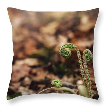Coiled Fern Among Leaves On Forest Floor Throw Pillow