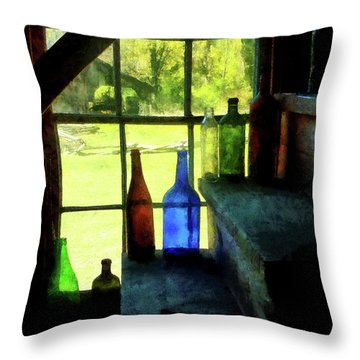 Throw Pillow featuring the photograph Colored Bottles On Steps by Susan Savad