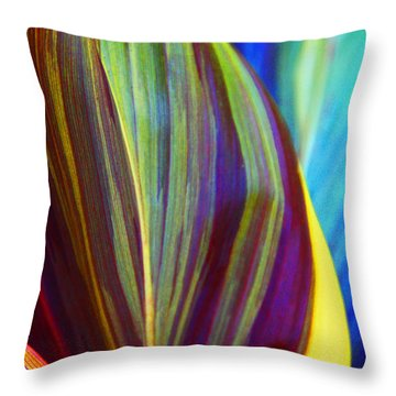 Throw Pillow featuring the photograph Colorful Ti Leaves by Kerri Ligatich
