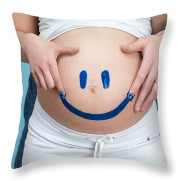 Couple Painting A Smiley On A Pregnant Woman's Belly Throw Pillow by Oleksiy Maksymenko