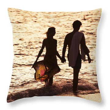 Couple Wading In Ocean Throw Pillow by Larry Dale Gordon - Printscapes