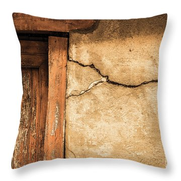 Throw Pillow featuring the photograph Cracked Lime Stone Wall And Detail Of An Old Wooden Door by Semmick Photo