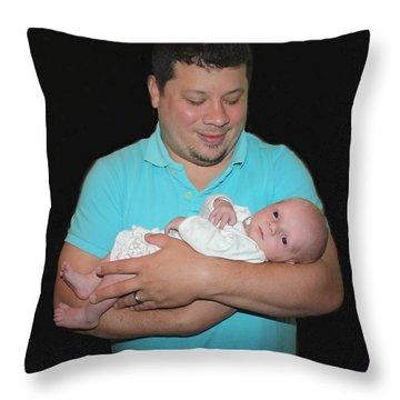 Cradling His Newborn Throw Pillow by Ellen O'Reilly