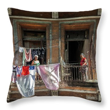 Throw Pillow featuring the photograph Cuban Women Hanging Laundry In Havana Cuba by Charles Harden