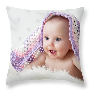 Cute Baby Laughing While Lying Under A Woollen Blanket. Throw Pillow