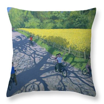 Cyclists And Yellow Field Throw Pillow by Andrew Macara