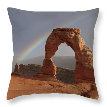 Throw Pillow featuring the photograph Delicate Arch And Rainbow by Marie Leslie
