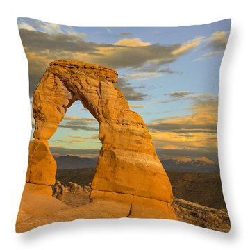 Delicate Arch At Sunset Throw Pillow by Adam Romanowicz