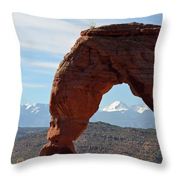 Throw Pillow featuring the photograph Delicate Arch With Wispy Clouds by Bruce Gourley