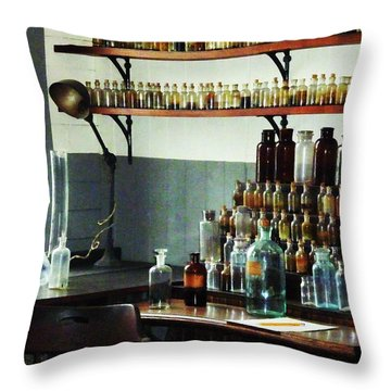 Desk With Bottles Of Chemicals Throw Pillow by Susan Savad