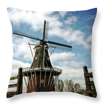 Throw Pillow featuring the photograph Dezwaan Windmill With Fence And Clouds by Michelle Calkins