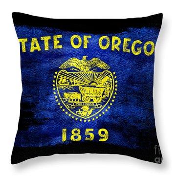 Distressed Oregon Flag On Black Throw Pillow by Jon Neidert