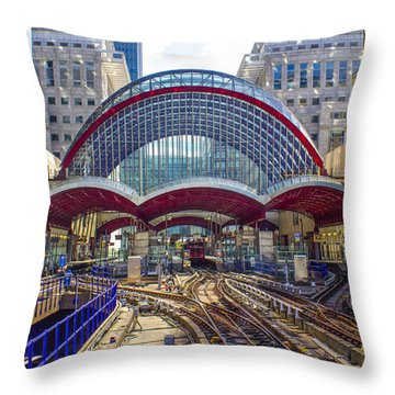 Dlr Canary Wharf And Approaching Train Throw Pillow