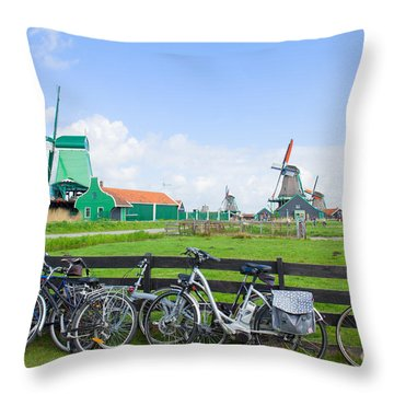 dutch windmills with bikes in Zaanse Schans Throw Pillow