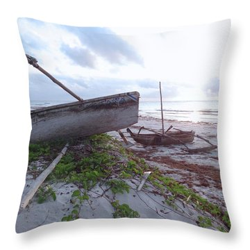 early morning African fisherman and wooden dhows Throw Pillow
