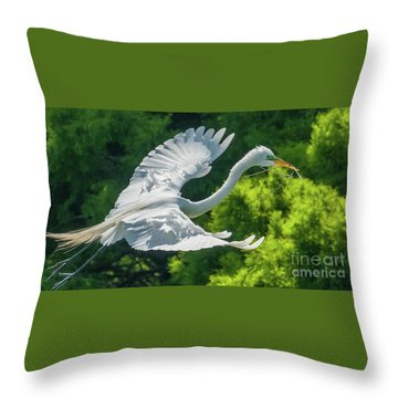 Egret Flying With Twigs Throw Pillow