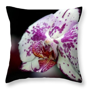 Exotica Throw Pillow