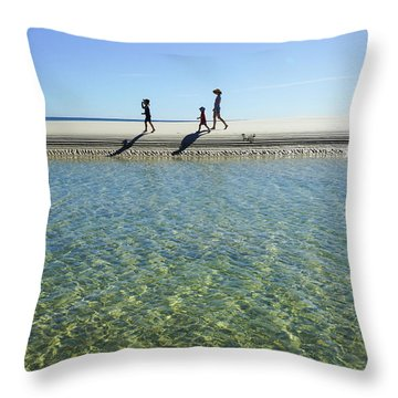 Exploring A Tidal Beach Lagoon Throw Pillow