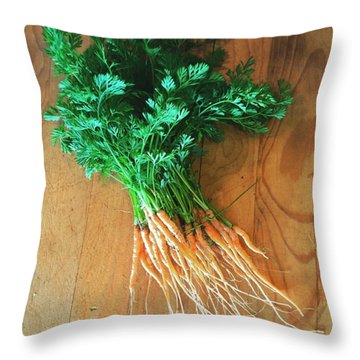 Fresh Carrots Throw Pillow by Nancy Ingersoll