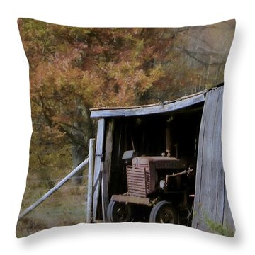 Throw Pillow featuring the photograph Farmall Tucked Away by Benanne Stiens