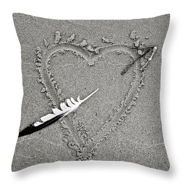 Feather Arrow Through Heart In The Sand Throw Pillow