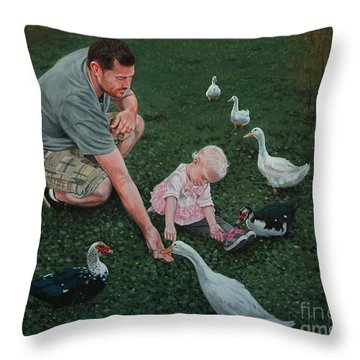 Feeding Ducks With Daddy Throw Pillow by Michael Nowak