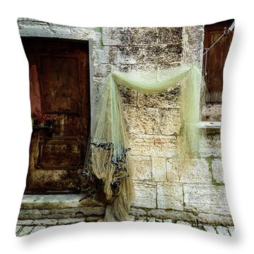 Fishing Net Hanging In The Streets Of Rovinj, Croatia Throw Pillow