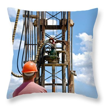 Throw Pillow featuring the photograph Fixing A Hole by Carl Young