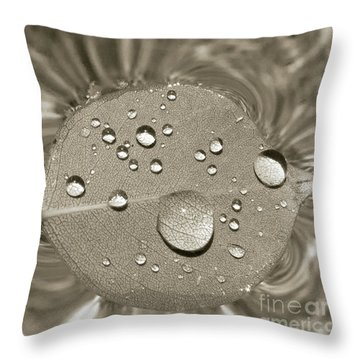 Floating Droplets Throw Pillow