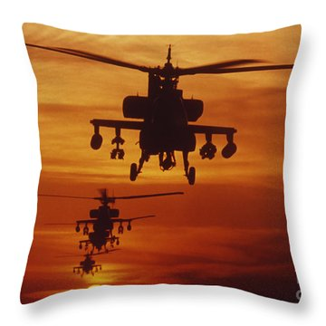 Throw Pillow featuring the photograph Four Ah-64 Apache Anti-armor by Stocktrek Images