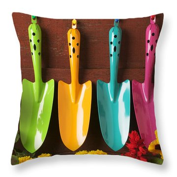 Four Colored Trowels  Throw Pillow