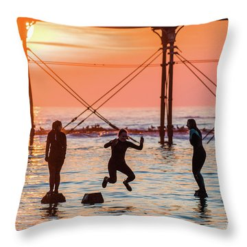 Four Girls Jumping Into The Sea At Sunset Throw Pillow