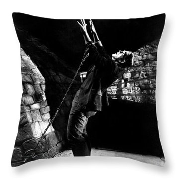 Frankensteins Monster Chained The Castle Played By Boris Karloff Throw Pillow