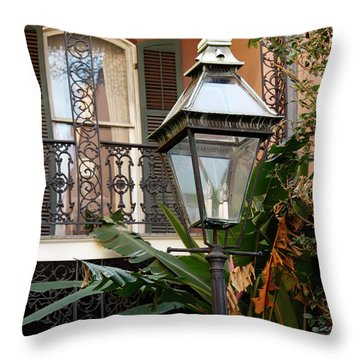 Throw Pillow featuring the photograph French Quarter Courtyard by KG Thienemann