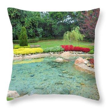 Garden At Epcot Throw Pillow by Kay Gilley