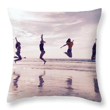 Girls Jumping On Lofoten Beach Throw Pillow