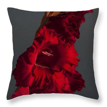 Gladiolus Against A Dark Cloud Throw Pillow