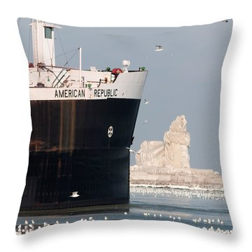 Great Lakes Ship Passing A Frozen Cleveland Lighthouse Throw Pillow