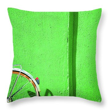 Throw Pillow featuring the photograph Green Wall And Bicycle Wheel by Silvia Ganora