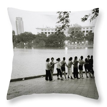 Group Massage Throw Pillow by Shaun Higson